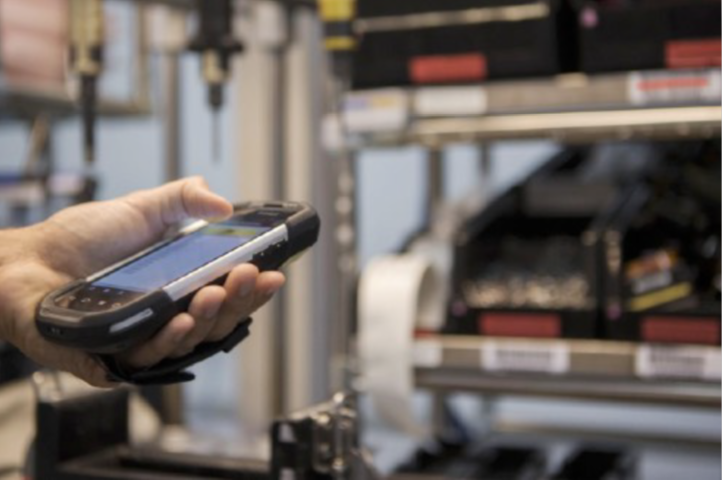 hand holding phone-type of barcode scanner
