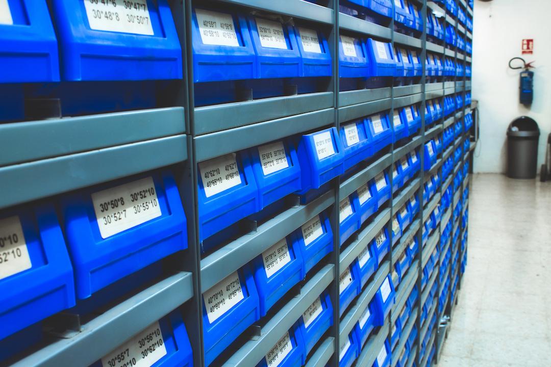 Warehouse plastic bins in a rack