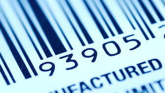 Barcode label with human readable. Closeup on light blue.